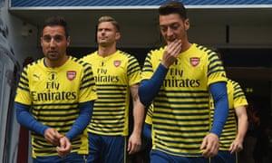 Santi Cazorla, Olivier Giroud and Mesut Özil of Arsenal