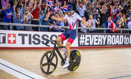 Jon Dibben crosses the line to win gold in the points race at the world championships.