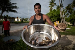 Joseph Iteba shows the fish that he caught to feed his family at Betio.