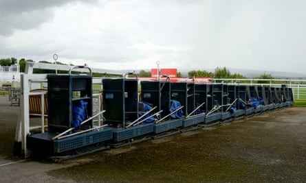 Bookmakers' stalls stand empty at Goodwood racecourse.