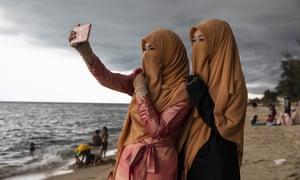 Thai women take a selfie on the beach