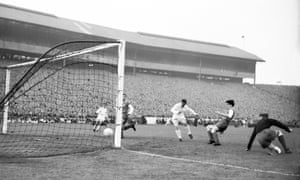 Real Madrid's Ferenc Puskas (third right) slots home his team's fifth goal, completing his hat-trick at Hampden.