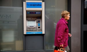 A woman outside a cash machine.