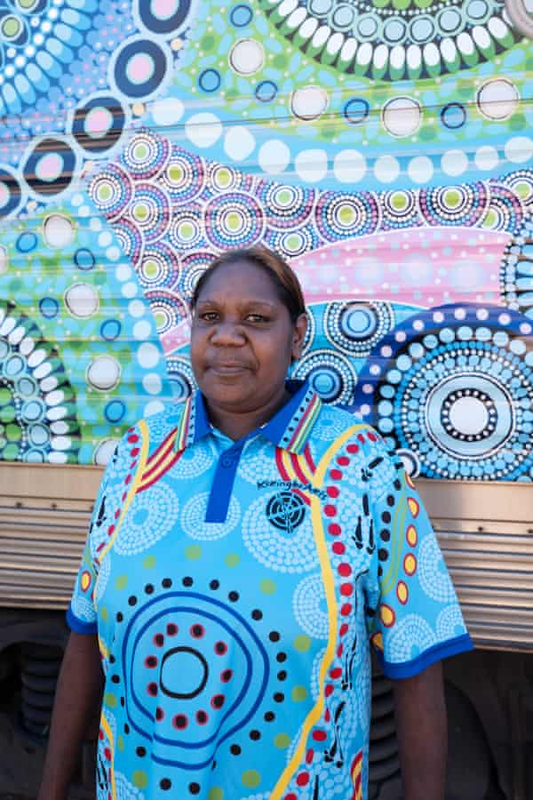 Chantelle Mulladad, of Keringke Arts, with her artwork Crossroads, which was commissioned by Parrtjima festival and has been wrapped around the Ghan.