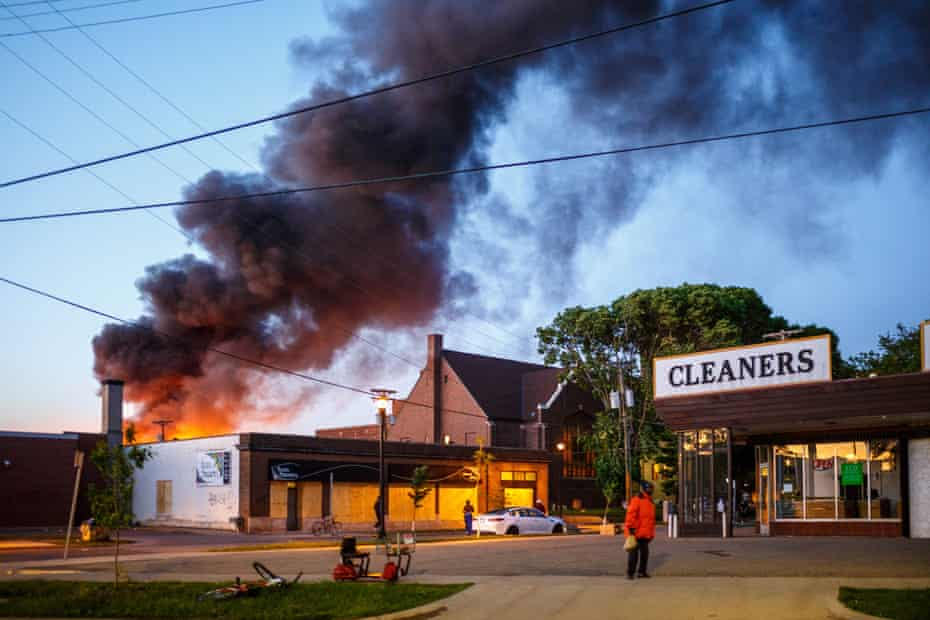 Flames rise from the cleaners shoop near the Third Police Precinct on May 28, 2020 in Minneapolis, Minnesota, during a protest over the death of George Floyd.
