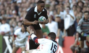Jonah Lomu charges through the tackle of Mike Catt to score a try during the Rugby World Cup semi-final at Newlands Stadium in Cape Town. New Zealand won the match 45-29.