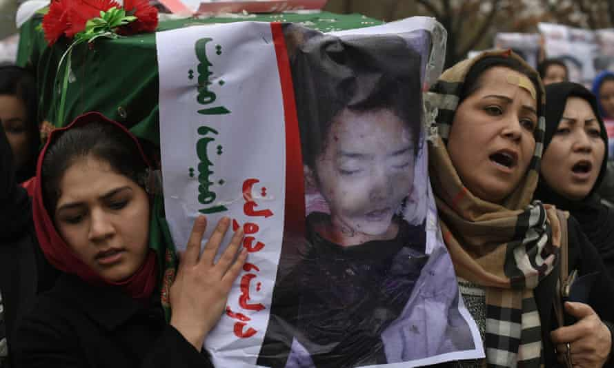 Protesters carry a coffin containing one of the decapitated bodies in Kabul