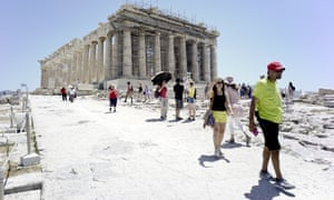 Tourists leave the Acropolis on 4 July in Athens, Greece, after it closed due to high temperatures