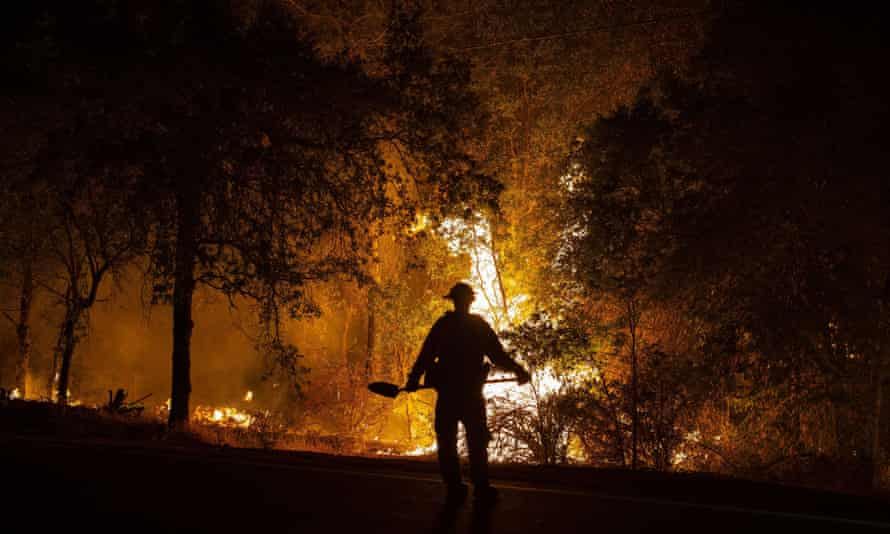 A firefighter watches the river fire near Colfax.