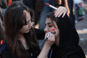 Baghdad, Iraq A protester gets her face painted with the colours of the Iraqi flag during anti-government protests in Tahrir square