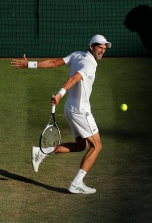 Novak Djokovic returns.