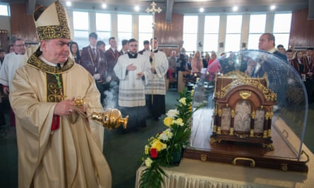 Bishop Joseph Toal, the bishop of Motherwell, blesses the relics of Saint Thérèse of Lisieux at their first stop at St Francis Xavier's, Carfin, North Lanarkshire.