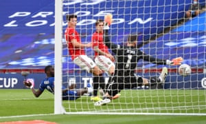 Antonio Rudiger of Chelsea challenges for the ball and Harry Maguire of Manchester United scores an own goal.