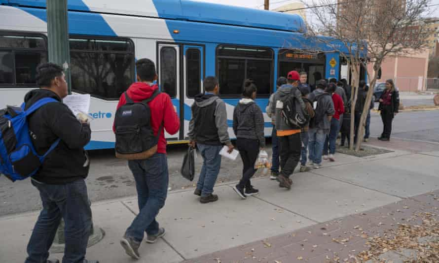 Migrants making their way to El Paso Sun Metro buses after being dropped off in downtown El Paso by Immigration and Customs Enforcement late in the afternoon on Christmas day.