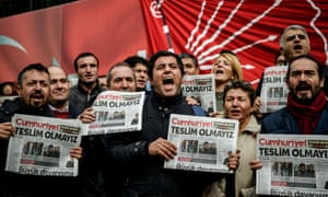 Protesters hold copies of Cumhuriyet outside the newspaper's headquarters in Istanbul on 1 November.