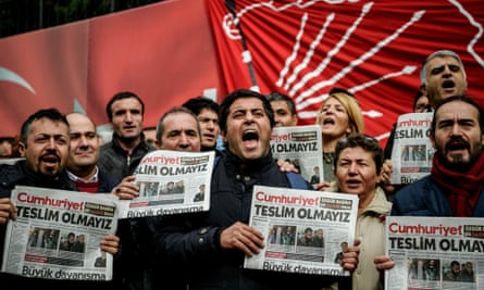 'The newspaper Cumhuriyet, known for its secular stance, is the government's latest target.' Demonstrators protest against the arrest of the paper's editor-in-chief last week.