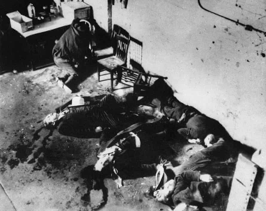 This 14 February 1929 photo shows the bodies of six of the seven men killed in the Valentine's Day massacre.