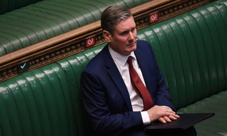 Keir Starmer sitting on the benches in parliament