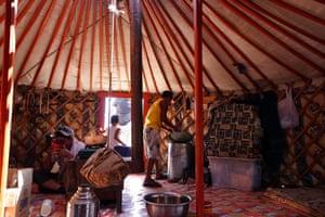 Orgiibayar fills water keg, ger, Khanbogd