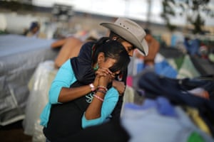 Jairo Gutierrez, 18, and Katerin Padilla, 15, from Honduras, part of a caravan of thousands of migrants from Central America trying to reach the United States, hug at a temporary shelter in Tijuana.