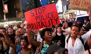 Activists march in New York City in protest to the recent fatal shootings of two black men by police: Alton Sterling and Philando Castile.