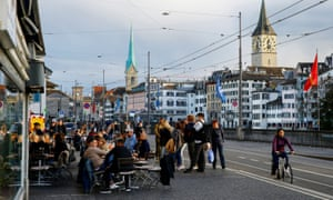 Guests sit outside of a restaurant in the old town of Zurich, on 22 May.