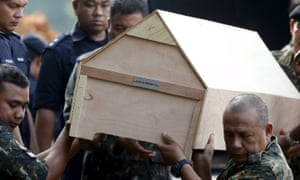 Malaysian police carry a coffin with unidentified remains of Rohingya people found at a traffickers camp in Wang Kelian in May 2015, to be buried in a mass grave near Alor Setar, Malaysia.