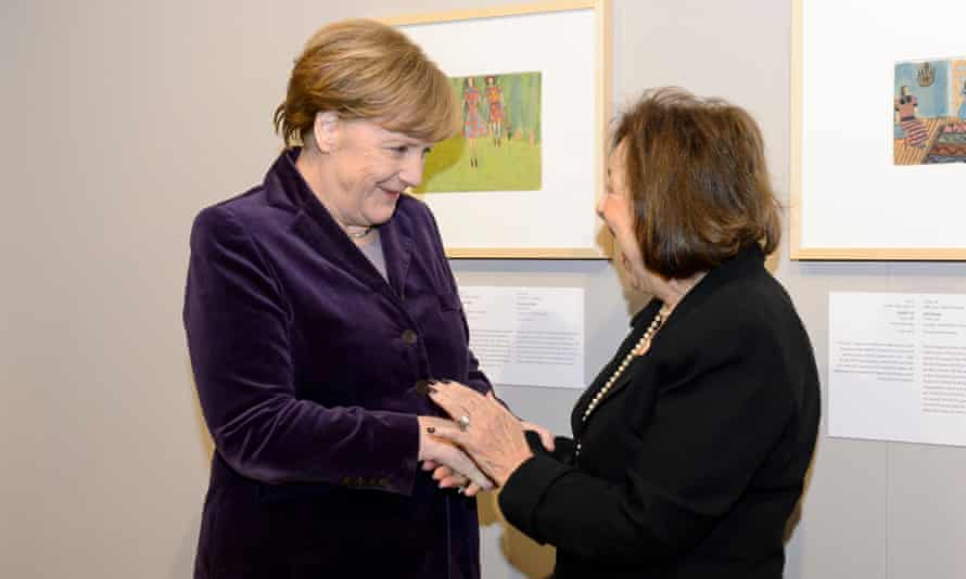 Angela Merkel greets Nelly Toll.