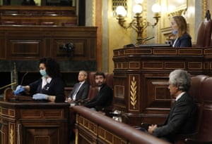 Madrid, Spain Cleaner Valentina Cepeda disinfects the podium in between each speech during the first prime minister's questions session held since the declaration of the state of emergency, in the lower house of the Spanish parliament