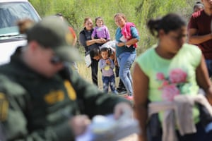 US border patrol agents take people into custody near the border.