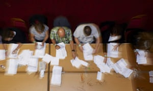 Counting staff sort ballot papers at a vote counting centre in Margate, Kent