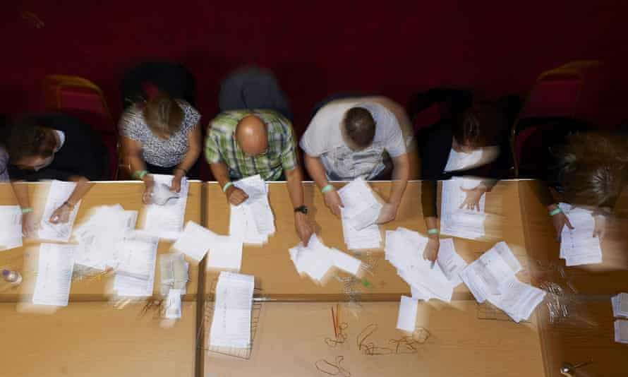 Staff sort ballot papers at a vote counting centre in Margate last year. The opinion polls failed to predict a Conservative victory.