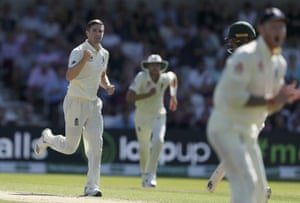 Woakes celebrates after taking the wicket of Usman Khawaja.