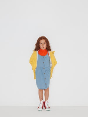 model wears coat, £24.99, zara.com. Orange jumper, £39, cosstores.com. Denim dress, £14, marksandspencer.com. Rainbow shoes, £18, next.co.uk.