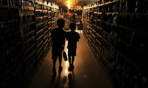Elijah Carter 11, left, and Robert Haralson, 12, shop in a darkened supermarket in Santa Rosa, California, during a blackout.