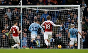 Sergio Agüero scores his and Manchester City's second goal against Arsenal.