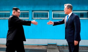 North Korea's leader Kim Jong-un prepares to shake hands with the president of South Korea.