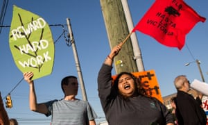 Activists shout during a Farm Labor Organizing Committee protest over pay and conditions in Durham, North Carolina.