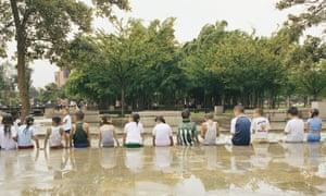 Children Sitting in the Water Features at the Parque de los Pies Descalzos