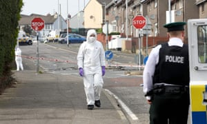 Police in the Creggan area of Derry after the shooting of Lyra McKee
