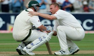 Andrew Flintoff consoles Brett Lee after England win an epic second Test at Edgbaston by two runs in 2005.