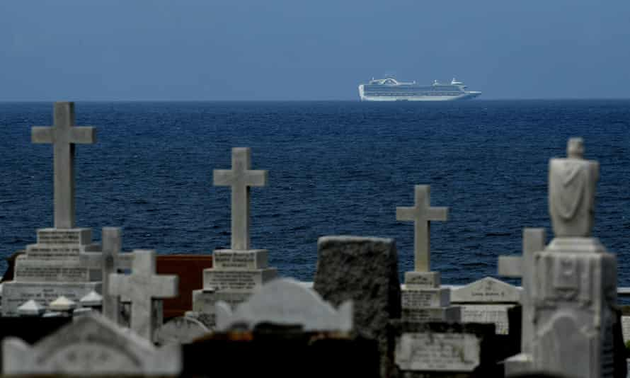 The Ruby Princess cruise ship, anchored at sea, is seen from a cemetery on the Sydney coast