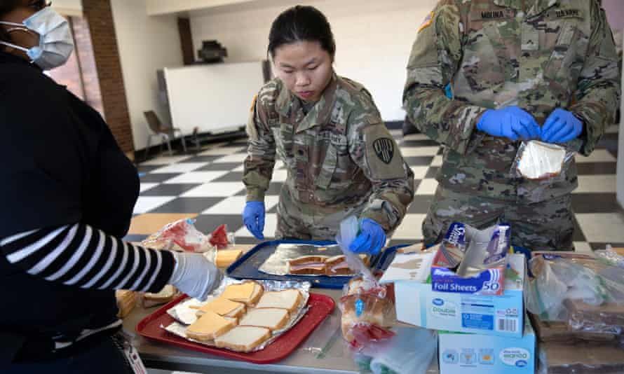 National guard troops put together sandwiches for coronavirus-affected residents in New Rochelle, New York.