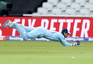 Jos Buttler dives to take the catch to dismiss Afghanistan's captain Gulbadin Naib.