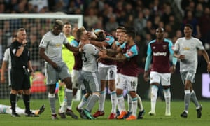 Tempers flare between West Ham's Andy Carroll and Luke Shaw of United after an incident between Paul Pogba and Mark Noble in the stalemate at the London Stadium.
