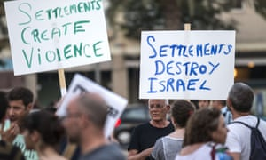 Israelis hold placards during a demonstration in Tel Aviv against the death of 18-month-old Ali Dawabsheh, the toddler who was burned to death by suspected Jewish extremists.
