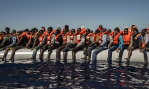 Refugees from Eritrea and other countries wait to be rescued from the Mediterranean Sea, north of Libya.