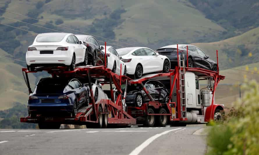 A car carrier hauler bearing electric vehicles departs Tesla's vehicle factory in Fremont, California, last year.