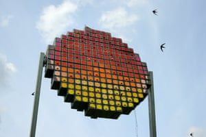 A massive swift tower comprising 100 nest boxes arrayed and coloured like a setting sun now stands in an urban park as a public art piece in Cambridge.