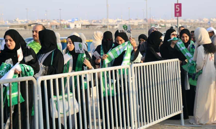 Saudi women queue to get inside the King Abdullah Sports City stadium in Jeddah on Friday.